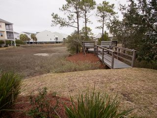 Folly Beach townhome photo - Backyard and seating area - perfect for grilling and relaxing with family