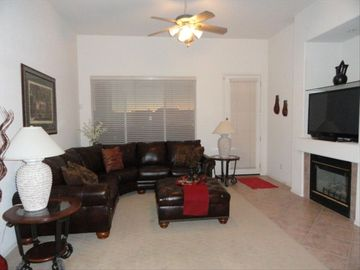 Comfy and cozy familyroom with a 52 inch flat screen tv and fireplace