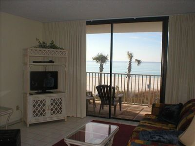 living room with flat screen TV and beautiful ocean view
