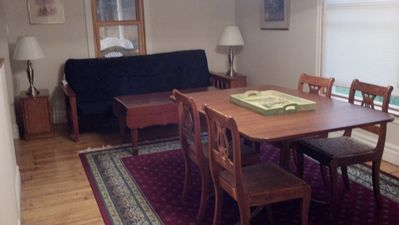 Dining Room in the House. There is a futon bed/couch. Dining table can fit 8-10.