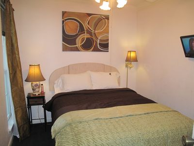 Galveston condo rental - Master Bedroom with ceiling fan and tall lit window or create a dark cozy den.