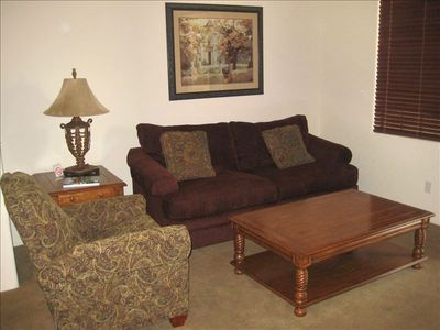 Large living room with sleeper sofa and reclining chair