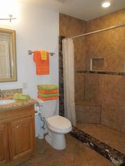 Galveston condo photo - Enter the spacious bathroom directly from the bedroom or the hall