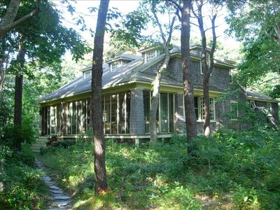 Exterior of the house in the woods showing beach path and the amazing porch