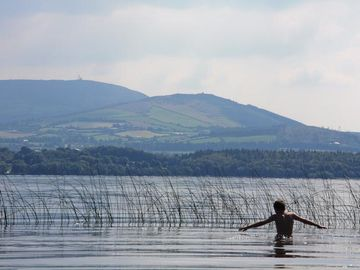 Swimming in Lough Derg With Tipperary Hills in the distance