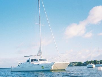 Take a FREE Sunset Cruise on our larger catamaran sailboats...