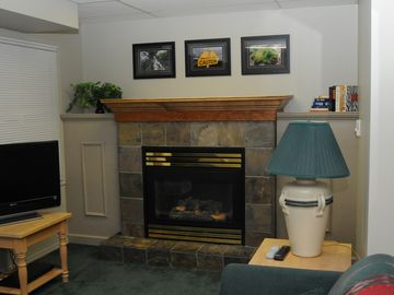 Lower Entertainment Area with Gas Fireplace and walk-out to Hot Tub