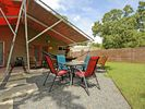 Outdoor Dining - Your whole group can enjoy a meal at the dining table in the backyard.