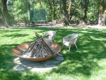 Copper Fire Pit with Trampoline in the Background