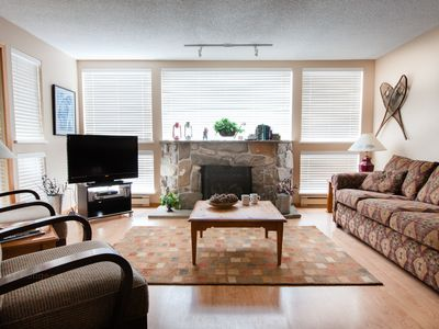 Living room with 46' flat screen TV and gas fireplace.