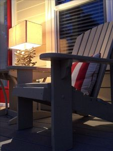 Enjoy reading in the evening on the deck off first floor guest room
