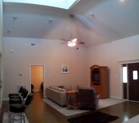 Coldspring house photo - 25ft high ceiling, modern, clean and bright living space.