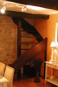 The colimaçon - spiral stairway from the lower level to the master bedroom/bath
