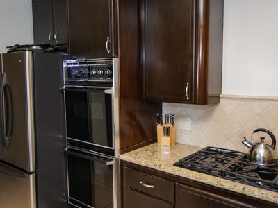 Whip up your favorite meal using the 6 burner gas range and double oven.