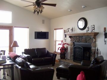 Upstairs Living Room with Fireplace, 40 inch TV with all movie channels