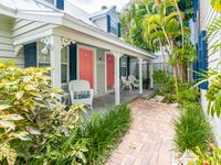 Two-level dog-friendly cottage w/shared pool, outdoor shower - near the beach