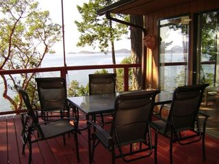 Pender Island house photo - Dining on the Deck for 6 comfortably. The sunsets are 'spectacular'.