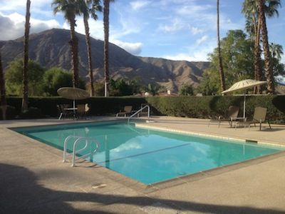 Palm Desert condo rental - One of 2 pools and hot tub complete with new patio furniture.