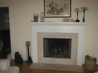 Large limestone fireplace with craftman mantle in living room
