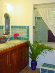 All bathrooms feature beautiful tilework. - Playa del Carmen villa vacation rental photo