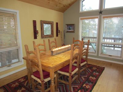 Dining area with large rustic table and chairs - Pagosa Springs Vacation Rental