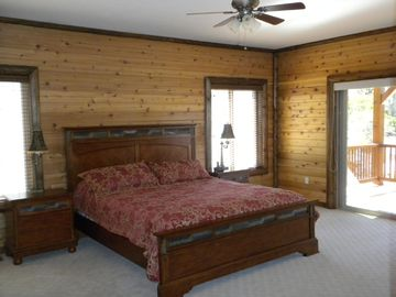 Master Suite downstairs - California king bed and access to rear lower deck