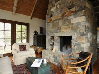 Livingston house photo - Beautiful rock fireplace in the living room and dining room