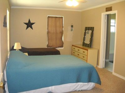 Master Bedroom downstairs with Full Bath.  1 King & 1 Twin bed