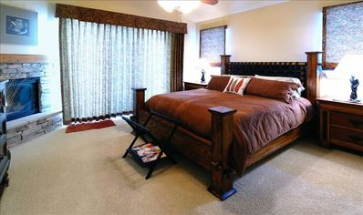 Expansive Master Suite with King Bed, Fireplace, Luxury Bath.