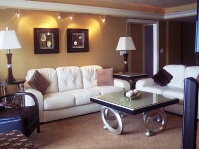 Living Room with white leather sofa and love seat