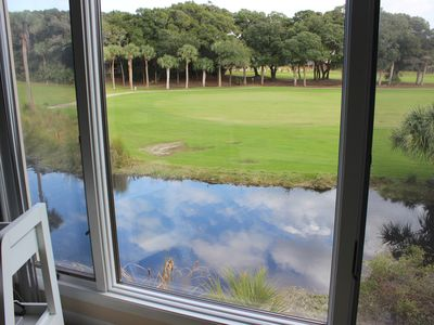 The living room has fabulous views of the lagoon and 18th fairway.