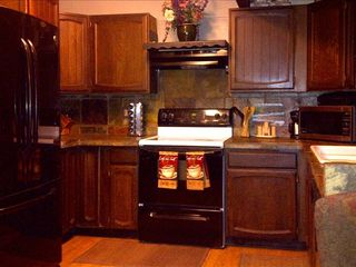 A full kitchen with a huge French door refrigerator!