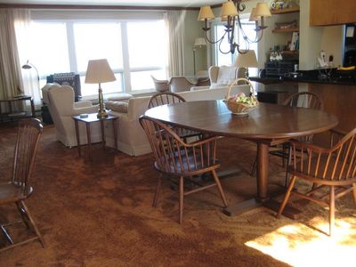 Dining area seats six with view of Lake Michigan
