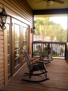 Porch includes, fans and rocking chairs and a gas grill.