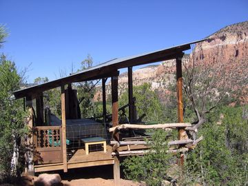 Ranch Casita's sleeping deck has two beds and a telescope.