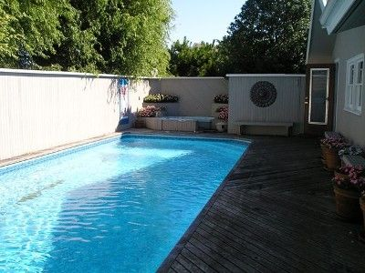 40 foot pool with seating area on three sides totally private