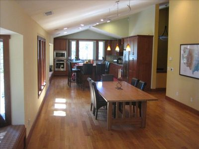 Upstairs great room overlooks driveway. Gourmet kitchen,dining table, wood floor