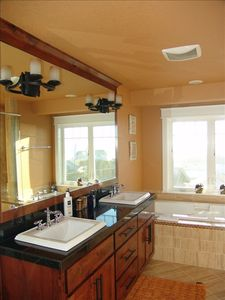 Master bathroom with ocean views, tub & walk-in shower
