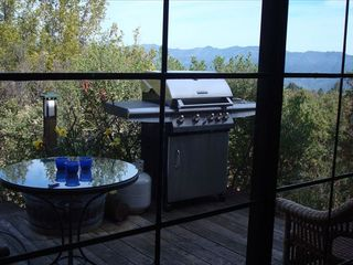 St Helena cottage photo - Private deck with a bbq, table, stunning views & steps down to lavender garden