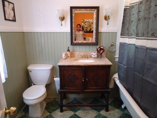 Dallas house photo - Antique claw tub w/overhead shower, entrance through Florentine room.