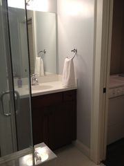 Savannah house photo - Vanity with corian top