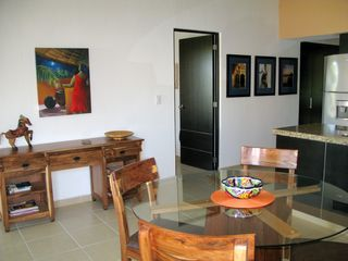 Tulum condo photo - Indoor and outdoor eating space. Original art throughout.