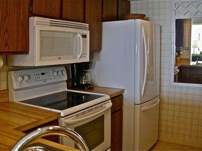 Kitchen is equipped with brand new, top end appliances.