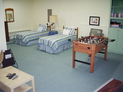 Bonus room has twin beds, game table, sofa & TV!