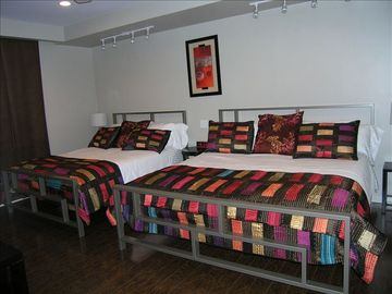 Spacious bedroom with king and queen sized beds