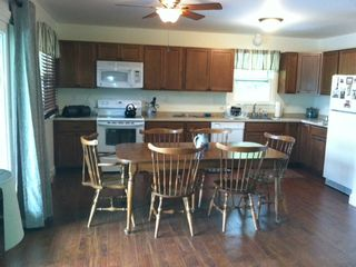 Barnstead house photo - Brand new maple kitchen cabinets, dishwasher, microwave and more!