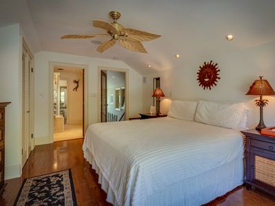 Master bedroom: overhead fan & king bed.