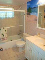 Fort Lauderdale house photo - Full second bath with beach and ocean mural keeps the Florida theme.