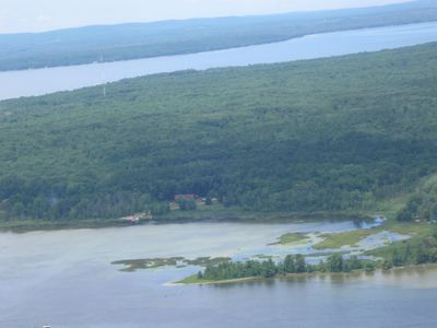 Aerial photo of property (13+ acres) with Burt Lake in the background