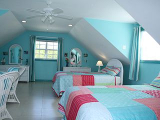 2 double beds in the large upstairs bedroom with ocean view - Spanish Wells cottage vacation rental photo